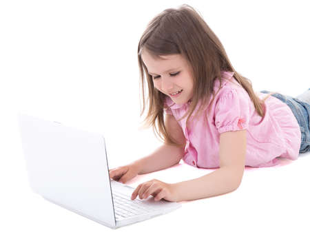 girls in jeans: cute little girl using laptop isolated on white background Stock Photo