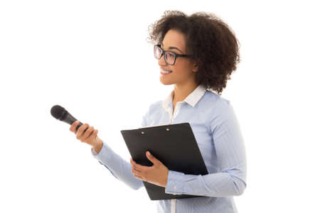 business news: african american female reporter with microphone and clipboard isolated on white background