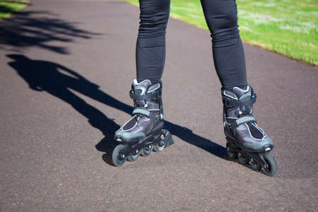 roller blade: close up view of slim legs in roller blades