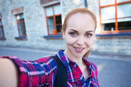 happy beautiful student or school girl making selfie photo Standard-Bild