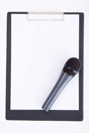 couching: speech concept - microphone and clipboard with blank sheet of paper