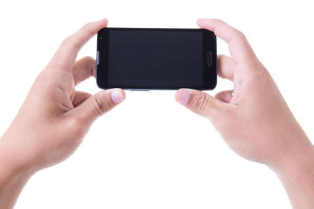 hands holding mobile smart phone with blank screen isolated on white background