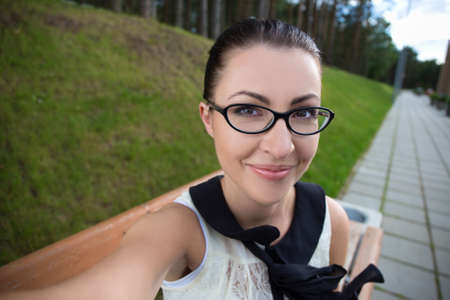 girl glasses: portrait of happy funny young woman making selfie photo Stock Photo