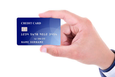 surname: close up of male hand holding plastic credit card isolated on white background Stock Photo