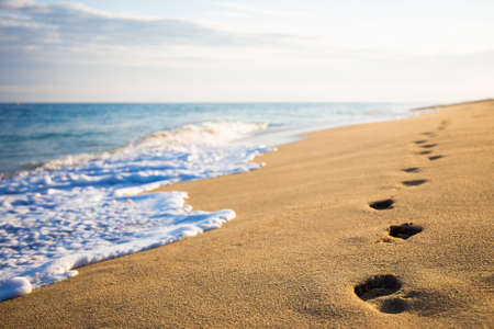 close up of footprints on the beach with golden sand Stock fotó - 46804422