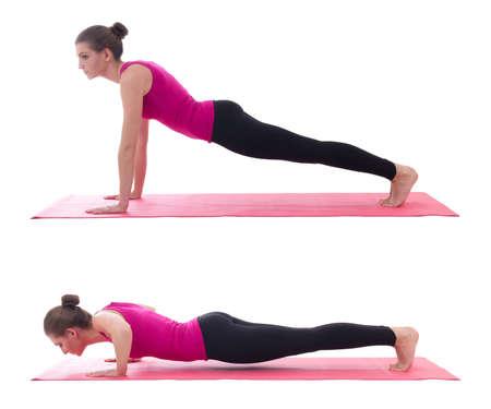sport concept, push up instruction -  beautiful woman doing push up exercise on yoga mat isolated on white background