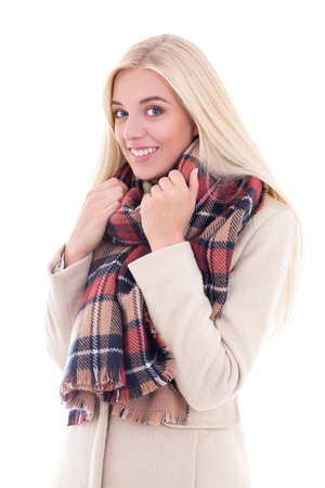 checkered scarf: happy young blond woman in warm clothes isolated on white background