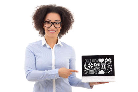 american media: beautiful african american business woman holding laptop with media applications isolated on white background