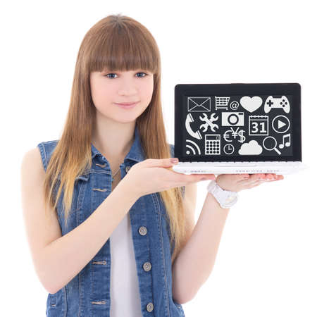 girl with laptop: software concept - cute teenage girl holding laptop with multimedia applications icons isolated on white background