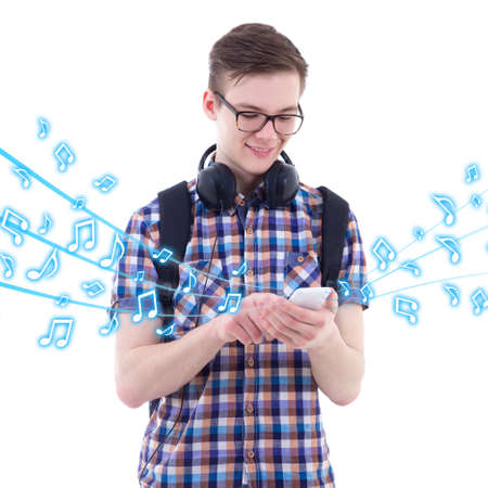 handsome boys: portrait of handsome teenage boy listening music with smart phone isolated on white background Stock Photo