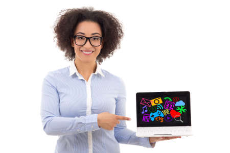 american media: beautiful african american business woman holding laptop with media icons on screen isolated on white background Stock Photo