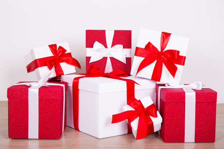 wrapped present: Christmas concept - close up of red and white wrapped present boxes