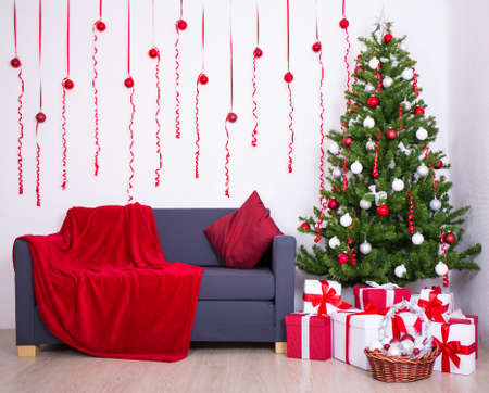 living: Christmas interior with christmas tree and gifts in living room Stock Photo
