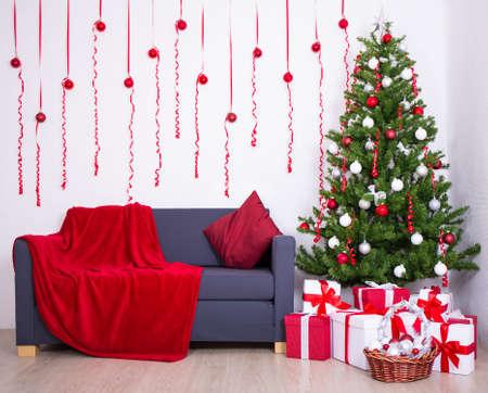 traditional living room: Christmas interior with christmas tree and gifts in living room Stock Photo