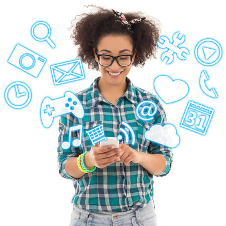 american downloads: beautiful african american teenage girl using mobile phone with different applications over white background
