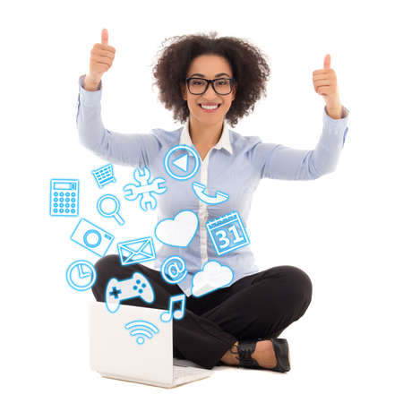 multitask: happy beautiful african american business woman sitting with laptop and thumbs up over white background Stock Photo