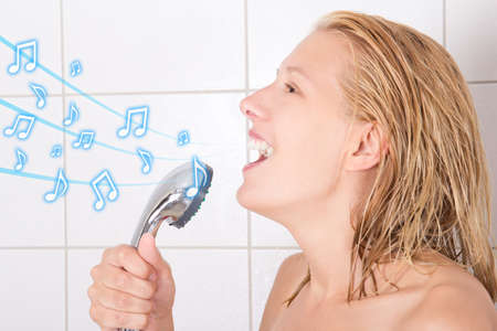 female in douche: young funny blond woman singing in shower
