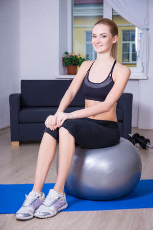 fit ball: young happy sporty woman with fit ball at home