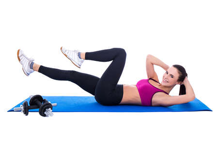 laying abs exercise: beautiful slim woman doing exercises for abdominal muscles isolated on white background Stock Photo