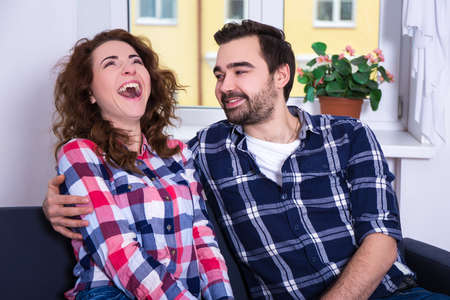 hysterics: funny laughing woman with her boyfriend at home