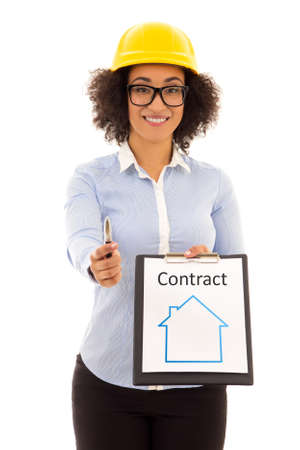 accommodation broker: construction and real estate concept - african american business woman in builder helmet with rent contract isolated on white background Stock Photo