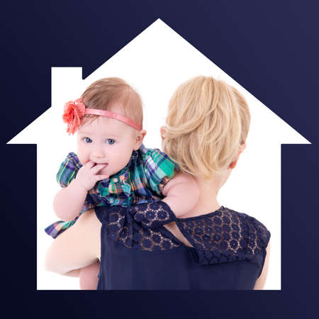 single mother: single mother concept - back view of young woman with cute baby in house frame