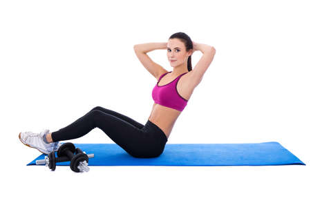 laying abs exercise: slim woman doing exercises for abdominal muscles isolated on white background