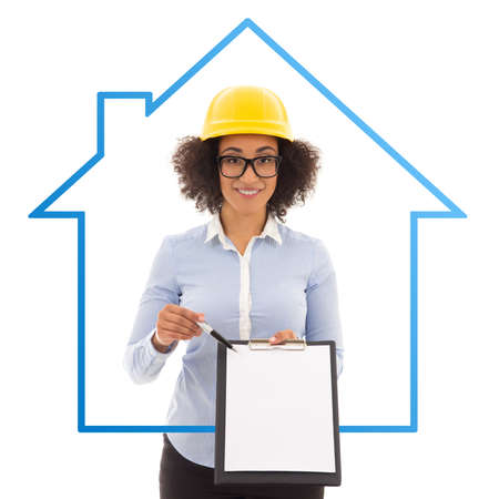 accommodation broker: construction and real estate concept - beautiful african american business woman in builder helmet showing blank clipboard isolated on white background Stock Photo