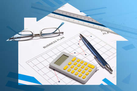 escrow: business and real estate - close up of graphs, charts, pen and calculator in blue house frame