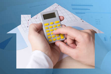 real estate concept - close up of male hands accounting something with calculator Stock Photo
