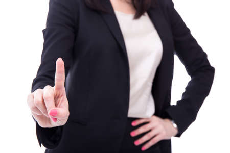 press button: business woman touching imaginary screen or pressing button with her finger isolated on white background