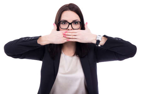 censorship: censorship concept - stressed young business woman covering her mouth isolated on white background