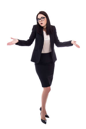 full length portrait of pretty business woman shrugs shoulders with open palms isolated on white background Stock Photo