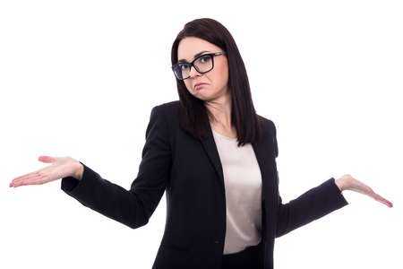 pretty business woman shrugs shoulders with open palms isolated on white background