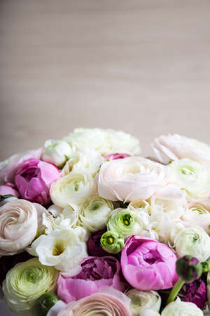 bunch up: close up of bunch of summer flowers over wooden background Stock Photo
