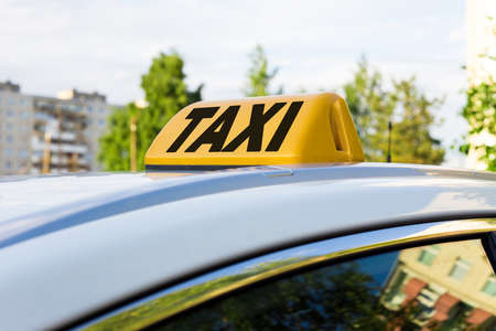 yellow lamp with taxi word on car roof