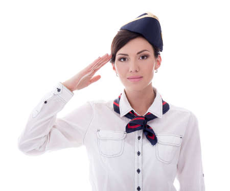 attractive young stewardess saluting isolated on white background Stock Photo