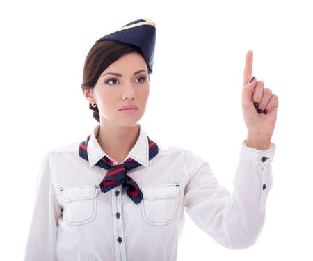 young stewardess in uniform pointing at something isolated on white background