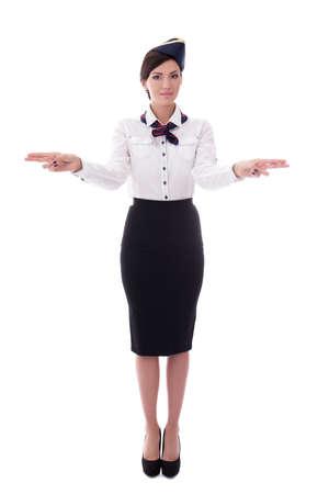 young stewardess indicating exits isolated on white background Stock Photo