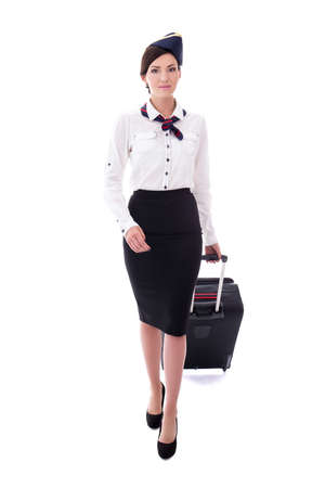 front view of young stewardess walking with suitcase isolated on white background