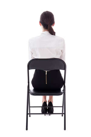 Back View Of Young Woman Sitting On Office Chair Isolated White Background Photo