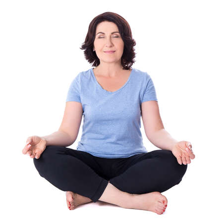 mature woman sitting in yoga pose isolated on white background