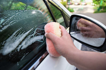 close up of handle car washing with foam sponge Stock Photo