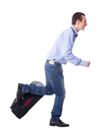 vacation concept - side view of middle aged business man running with suitcase isolated on white background Stock Photo