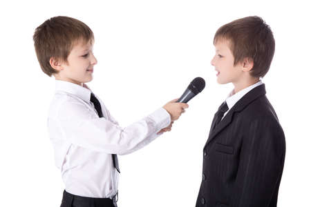 cute little boy reporter with microphone taking interview isolated on white background