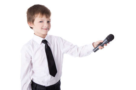 cute little boy in business suit with microphone taking interview isolated on white background