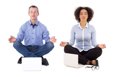 business man and business woman sitting in yoga pose with laptops isolated on white background