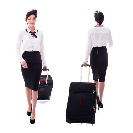 front and back view of young stewardess walking with suitcase isolated on white background