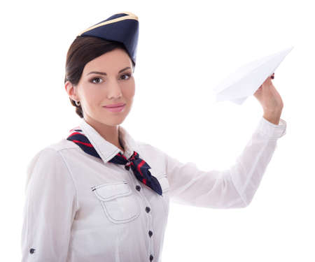 portrait of young stewardess with paper plane isolated on white background
