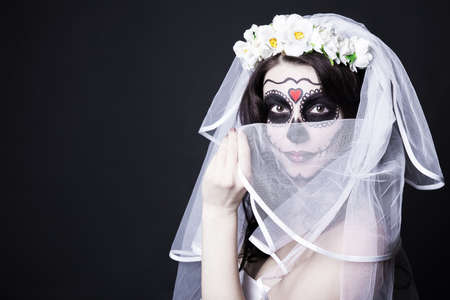 sugar veil: Halloween concept - woman bride with creative sugar skull make up and bridal veil over black background